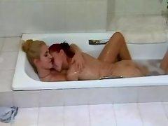 Hot chick licks tasty pussy in bath