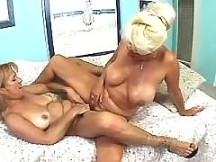 Two mature lesbians play with pussy