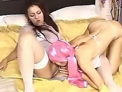 Lesbians lick each other in bedroom
