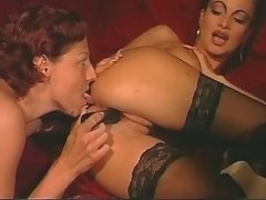 Mature lesbian spoils chick on sofa