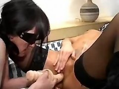 Masked lesbians in black stockings