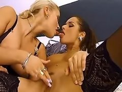 Blond lesbian caresses pussy on bed